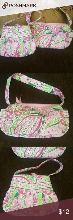 Vera Bradley small purse Vera Bradley  Small handbag (2 available)  Pattern: ? Colors: Pinks, green and white   Liquidating items. Vera Bradley Bags