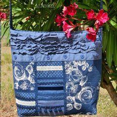 И сама сумка поближе. Получилась такая красивая и удобная сумка, что почти все лето с ней проходила. 🌸🌸🌸. The upcycled bag, closer view. The bag is so nice and comfortable, my favourite of this summer. #alpensee #alpensee_bags #recycling #upcycled #patchwork #patchworkbag #пэчворк #лоскутнаясумка #кастомайзинг #переделка #шьюсама #сумкаручнойработы #customized