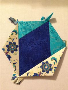 "Katja Marek's The New Hexagon - Millefiore Quilt-Along: Rosette 1: ""block 30 - Debbie altered"" -- completed by Tracy Pierceall, 1/7/2015"