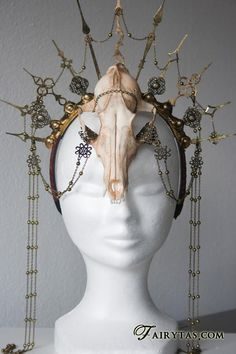 Awesome headpiece. Build everything onto a comb headband. Cover headband with ribbon or fabric or metal. Connect clock hands pointing up, symmetrically. Skull attached with chains & chains between clock hands. wear over wild hair.