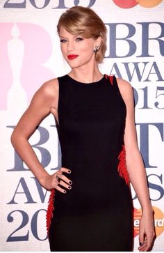 a681d08eb7 taylor swift brit awards 2015 red carpet 06 Taylor Swift shows off the  gorgeous dragon on her dress on the red carpet at the 2015 BRIT Awards held  at The ...