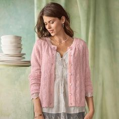 LA ROSA CARDIGAN - Our lacy, pointelle knit cardigan assures a good day—or evening. Light as a breath, finished with a scalloped hem, shell buttons and velvet-ribboned placket. Nylon/kid mohair/lambswool.