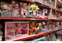 Dolls and toys for sale in a toyshop, Newmarket Suffolk UK - Stock Image