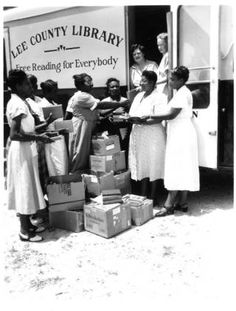 Lee County Library - Free Reading for Everybody (Women at Lee County mobile library :: CHARM Digital Collection)