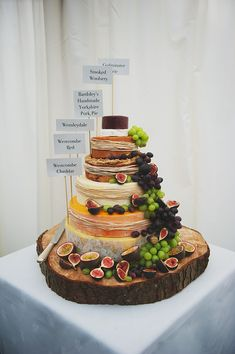 """We decided early on that we wanted a cheese wedding cake as, quite simply, we both love cheese.  My mum found the base at a builders yard! Our friend Katie baked us a huge handmade pork pie as one of the tiers, and the other delicious layers were from The Cheese Shed online.""  Brilliant."