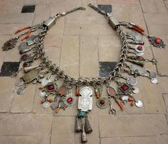 by Faouzi Creations | A wonderful robust fibula chain with a multitude of wonderful antique Berber pendants | Sold