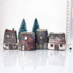 Raku pottery fired Ceramic houses with silver/bronze/copper roof. Hand sculputed houses with beautiful colours which changes with lights on them are perfect for a little nook of the house. Raku glazes contain a lot of silver that gives the fired pieces beautiful bronze, blue and