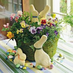 Easy Easter Decorations < Spring Table Settings and Centerpieces - Southern Living Easter Flowers Decorate your Easter table with colorful blooms, candies, and bunnies. Hide the flowers' container with moss for a fresh, Spring look. Easter Flower Arrangements, Easter Flowers, Easter Centerpiece, Spring Flowers, Centerpiece Flowers, Easter Colors, Flower Decoration, Basket Decoration, Centerpiece Ideas