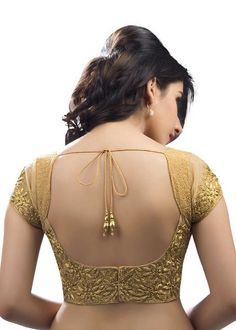 Stunning Embroidered Gold Ethnic Sari Blouse KP-94SL The intricate embroidery of rich gold zari work on this blouse gives it a very attractive and flirty look. With transparent net sleeves and fancy zari kundan embroidery all over, this blouse goes well on absolutely any saree or Lehenga. The gorgeous cut back adds that extra glamour to your impression. The added zari work on the sleeve also gives a modest yet stylish look.Match it with any of your favorite sari or lehenga, and be the…