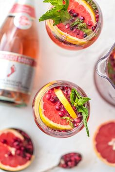 PINK CHAMPAGNE SANGRIA is the perfect New Years Eve cocktail! Ring in the new year with style, and lots of pink bubbly! Champagne mixed with grapefruit juice, pomegranate juice, and mint simple syrup, seriously delish!