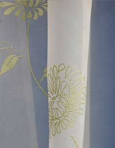 Bold and beautiful ivory voile panel made with sheer fabric and embossed with subtle green flower print design, both silhouette and outline