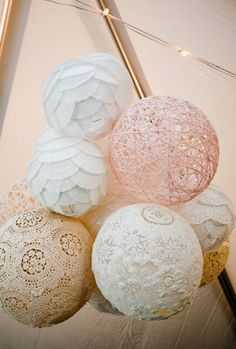 These are done with doilies, doilie thread, balloons and glue. The strings balls are more time consuming than the doilies.