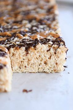 TOASTED COCONUT CARAMEL RICE KRISPIE TREATS: Move over classic rice krispie treats! These toasted coconut caramel rice krispie treats are ridiculously delicious...so easy and a total showstopper! | melskitchencafe.com