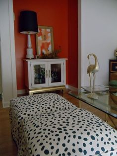 coral alcove, cabinet, lamp, spotted ottomans. new I liked that polka dot fabric @Anne Cranz