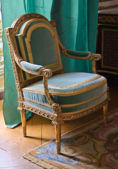 Marie Antoinette's armchair from the Palace of Versailles. It was made by French cabinet maker Georges Jacob (1739-1814). This blue & yellow gold chair was kept in the Queen's private Gold Cabinet room.