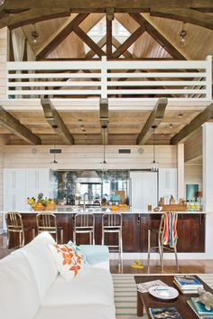 Picture of loft in 10 ceiling pole barns joy studio for Beach house plans with loft