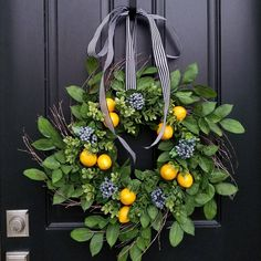 Your front door deserves the best this summer!!! This lemons and blueberry wreath is sure to turn heads as neighbors stroll by. :) This wreath was a HUGE hit about 6 years ago until I ran out of material. This is my new version of my lemons and blueberries but now you have options!! Ive