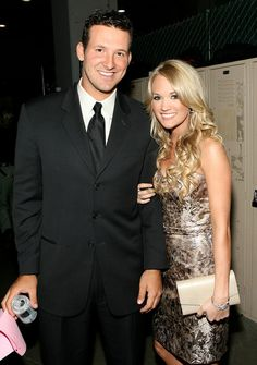 Tony Romo Photos Photos - *EXCLUSIVE/MINIMUM PRICING*  Singer Carrie Underwood (R) and Quarterback Tony Romo of the Dallas Cowboys pose backstage at the 42nd Annual Academy Of Country Music Awards held at the MGM Grand Garden Arena on May 15, 2007 in Las Vegas, Nevada. - 42nd Annual Academy Of Country Music Awards - Audience And Show