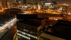 Stock Footage of Night timelapse shooting down between buildings onto a street with peak traffic, buildings and a taxi rank in the city centre of Johannesburg, South Africa. Explore similar videos at Adobe Stock City Scene, A 17, Stock Video, Taxi, Stock Footage, South Africa, Centre, Adobe, Night