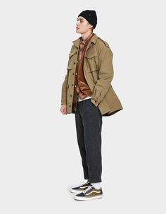 Military-inspired jacket from BEAMS PLUS in Khaki. Removable hood with adjustable drawcord.