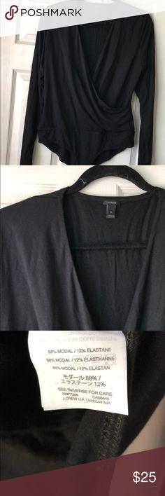 """NWOT J. Crew Wrap Bodysuit NWOT J. Crew bodysuit in a faux wrap style that is unbelievably soft. It was just a little too revealing for my larger bust and 5'10"""" frame. No hygenic liner or tags, but never worn. Really beautiful. J. Crew Tops"""