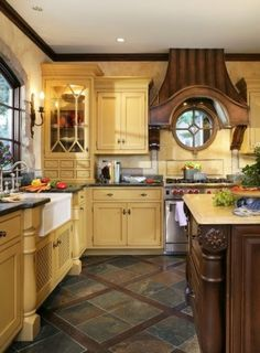 Love the earth tone colors, the flooring, cabinet style, and farmhouse sink.
