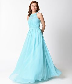 This stunning aqua chiffon dress is simply a dream! It has a halter, sheer illusion neckline, and a padded bust for support. The waist band fastens in the back with the skirt slightly pleated falling at your sides effortlessly.