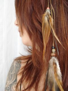 feather roach clip as hair accessory