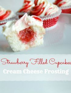 Strawberry Filled Cupcakes with Cream Cheese Frosting http://ahelicoptermom.com/strawberry-filled-cupcakes-cream-cheese-frosting-recipe