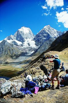 Trekkers above lake Carhuacocha in Cordillera Huayhuash, Peru