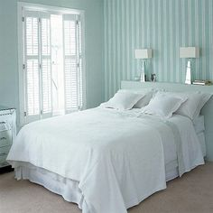 Small bedroom ideas - love the colored stripes in an all white room