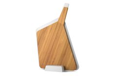 A modern sculptural chopping board set that combines ergonomic wood and plastic boards in a striking, easy to store design solution.