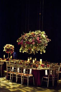 The Civic Opera House is transformed into an Italian Garden with these large rose centerpieces hung from the rafters.  Floral & Decor: http://KehoeDesigns.com, Photography: Edenhurst Studio, Planning: Big City Bride