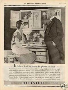 His daughter looks like a servant....Hoosier Kitchen Cabinet (1928)
