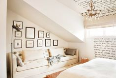 A reading corner with the angled ceiling in a warm and cozy bedroom