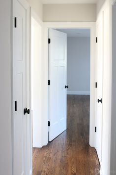 Love these white craftsman style doors for this home renovation. The black hardware from Kwikset really pops on these fresh doors. Love the matte black hardware.