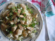 Chinese Chicken Salad- Trader Joe's Asian Style Spicy Peanut Vinaigrette, the preshredded coleslaw mix and leftover chicken breast chopped. A few toasted sesame seeds, sliced almonds and green onions .