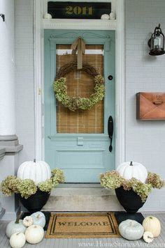 Robin Egg Blue Door. Love the wreath too!