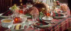 This table is set for a traditional Finnish Christmas dinner, with the baked ham taking centre stage