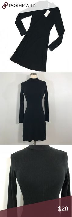 American Apparel Mock Neck Dress • Black ribbed long sleeve dress that's fitted on the top and is loose on the bottom. American Apparel Dresses Mini