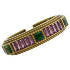 """1989 Kieselstein-Cord Tourmaline & Yellow Gold Bangle Bracelet. Bold and colorful bracelet. Nice and heavy. Geometrical and three-dimensional. Tasteful combination of signature Kieselstein-Cord greenish gold with pink and green tourmaline. Created in 1989. Signed and hallmarked for 18k gold. Perfectly fits up to 6.5"""" wrist. 5/8"""" wide."""