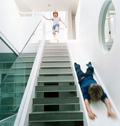 Staircase slide... I want this for my house. I would have so much fun!