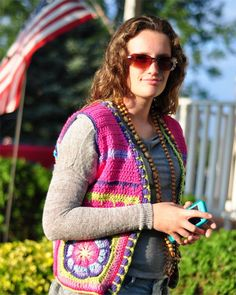 This beautiful crochet vest is a mandala of color. Showing off the pattern of Sophies Garden. Multiple colors and hues. This will be a lovely