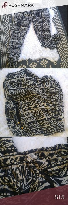 Charlotte russe Aztec joggers Super cute Aztec print Charlotte russe joggers are cinched at the ankle and extremely light weight and comfortable! Size large is juniors and fits more like a women's medium in my opinion. They fasten with a hook as well as a zipper and have a cute drawstring with decorative metal squares attached. Charlotte Russe Pants Track Pants & Joggers