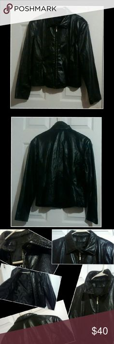 Wilsons The Leather Experts Woman's Leather Jacket Quality Jacket.  Zippered front with cute button detail near collar.  Condition: Great Pre owned condition!  Flaws: some pilling on left sleeve bottom and 2 gray marks.(maybe leather cleaner can remove them!) Button flap has some pilling as well. Other flaws seem to be wrinkles and a teeny tiny white speck on back. (Probably can't see it pictured) photo 3.  Outer Shell: 100% Leather Inner: 100% Polyester 100% Nylon  Smoke and Pet free home…
