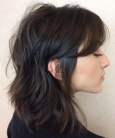 Messy Textured Hairstyle with Side Bangs