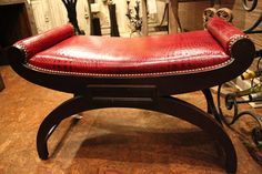 Take a look at how #vibrant and #exquisite this red #leather and #mahogany combination is! #WHLuxe loves the #style & #texture of this #ottoman. Own it today! #InteriorDesign #LeatherOttoman #RedLeather #Unique #UniqueOttoman #LuxuryHomes #LuxuryLiving #Furniture   For more information visit www.WHLuxe.com