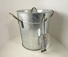 Ice Bucket and Lid are galvanized steel. Description from bonanza.com. I searched for this on bing.com/images