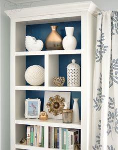 Top a basic bookshelf with crown molding to make it look built-in:
