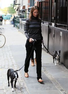 Christy Turlington walking with Fitzy and Micky.